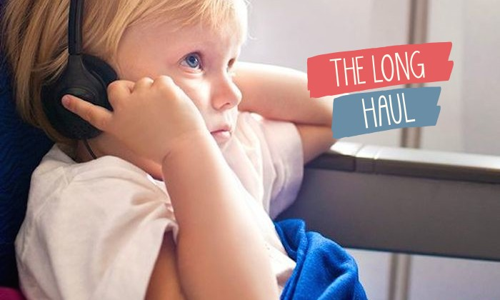 A child wearing headphones on the plane